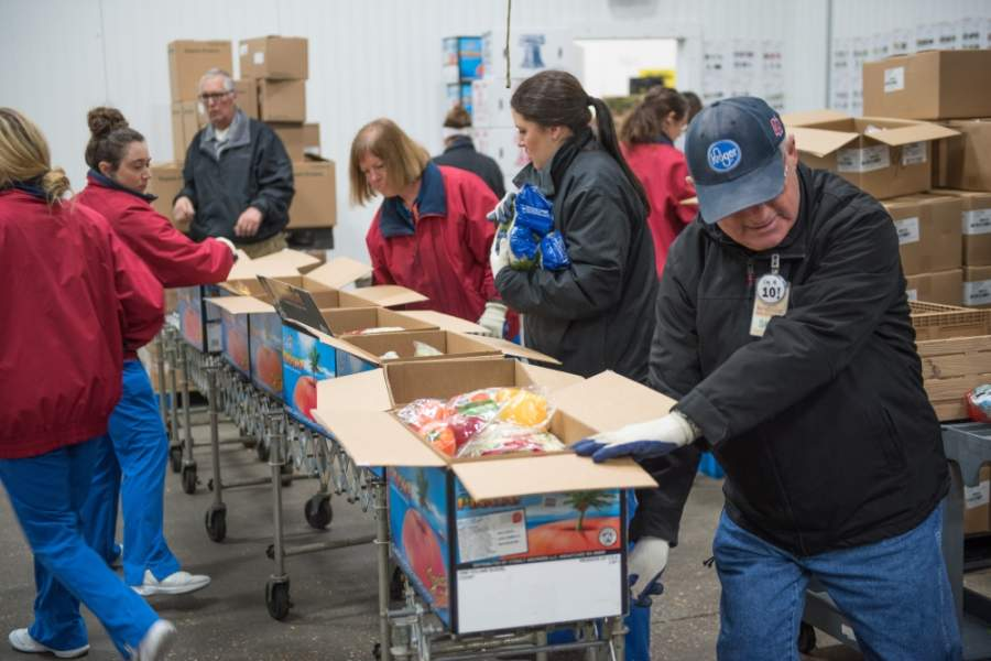 Volunteers pack boxes of food at the food bank. (Photo by Montgomery County Food Bank)