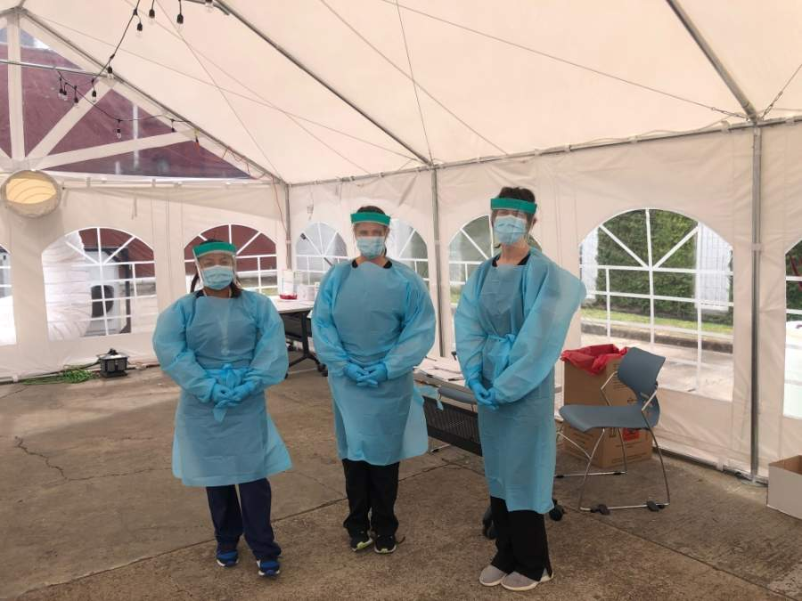 Three Legacy Community Health Services Inc. staff members stand in a COVID-19 testing tent. The health care center is receiving a $2 million federal grant to expand its testing capabilities. (Courtesy Legacy Community Health Services Inc.)