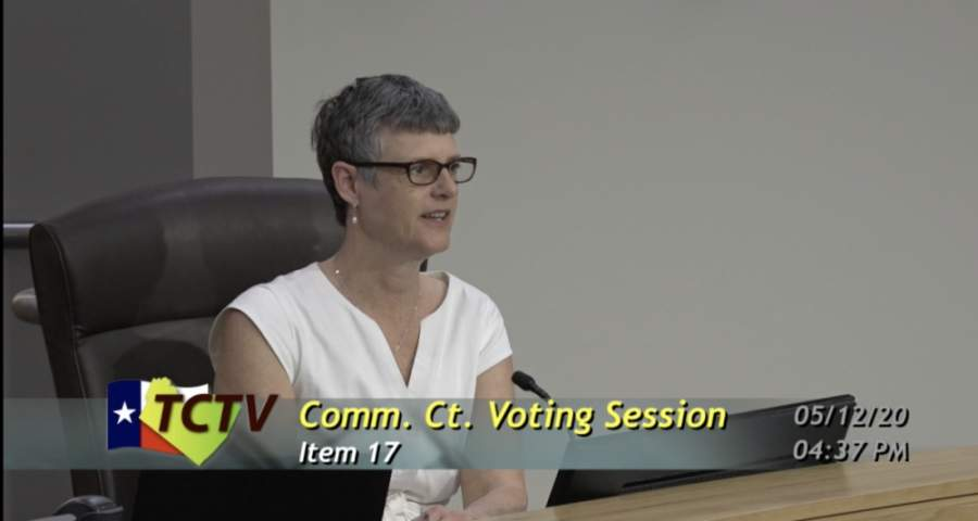 A photo of Sara Eckhardt at a commissioners court meeting