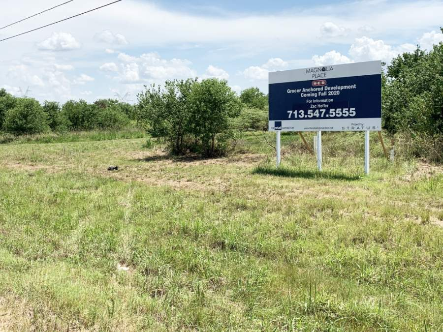 The city of Magnolia's planned H-E-B has been put on hold due to the coronavirus pandemic. It was previously slated to debut this fall, according to the sign posted at the property in 2019. (Kara McIntyre/Community Impact Newspaper)