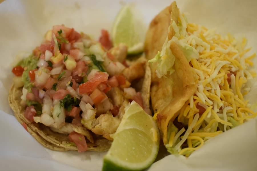 Oscar's Taco Shop has a variety of tacos on its menu for $3 or less, including the chicken taco (left) and the ground beef taco (right). (Alex Hosey/Community Impact Newspaper)