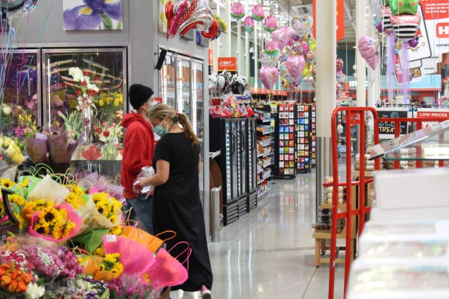 Shoppers wear face masks while inside a Katy-area HEB. (Nola Z. Valente/Community Impact Newspaper)