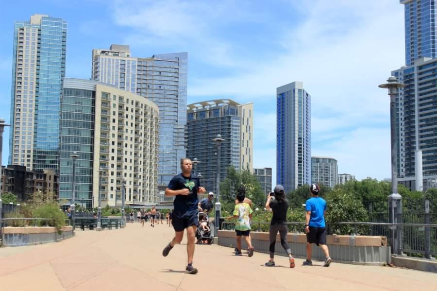 Austinites walk, run and bike on the Pfluger Bridge on a warm late spring afternoon. (Jack Flagler/Community Impact Newspaper)