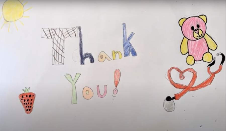 Theiss Elementary School students demonstrated their gratitude towards health care providers and those working on the front lines of the ongoing coronavirus pandemic by participating in a three-week art project directed by the school's art teacher, Connie Shin. (Screenshot via YouTube)