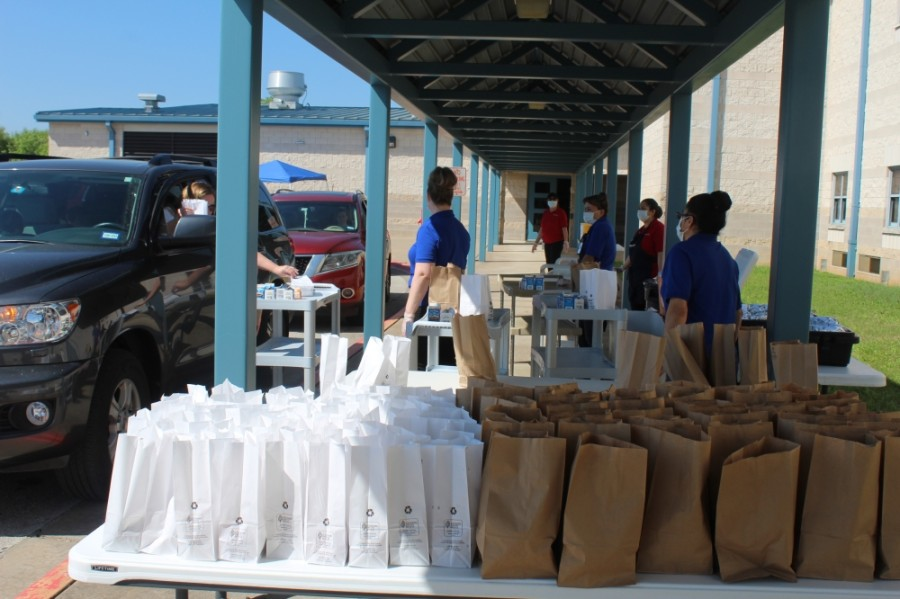 Leander ISD will continue its free food drive-thru program (pictured) at three campuses from June 1-July 31. (Brian Perdue/Community Impact Newspaper)