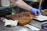 For Spring-area barbecue joint CorkScrew BBQ, owner and pitmaster WIll Buckman said steep price hikes in meat products have added to the challenge of operating a restaurant amidst the coronavirus pandemic. (Adriana Rezal/Community Impact Newspaper)