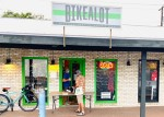 A photo of a man making a curbside purchase at Bikealot