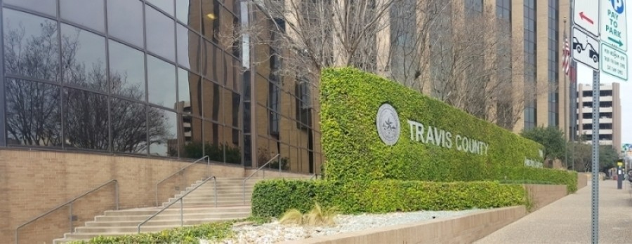 A photo of the Travis County headquarters sign