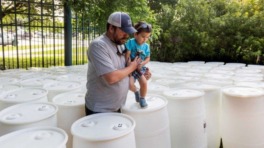 The syrup drums being repurposed into rain barrels were donated from Coca-Cola. (Courtesy Galveston Bay Foundation)