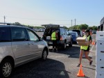 Volunteers load cars at a distribution event in South Austin on May 28. (Nicholas Cicale/Community Impact Newspaper)