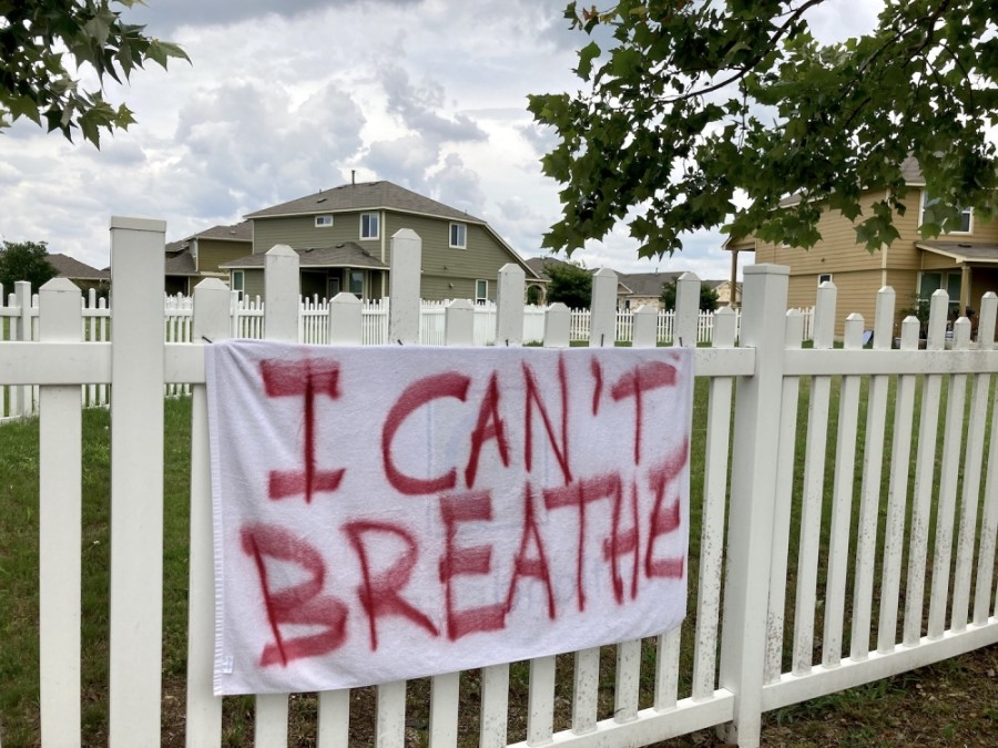 A handmade banner is displayed outside a Round Rock home, referencing some of the final words of George Floyd. Floyd, an unarmed black man, was killed in Minneapolis by then-Officer Derek Chauvin on May 25. (Taylor Jackson Buchanan/Community Impact Newspaper)