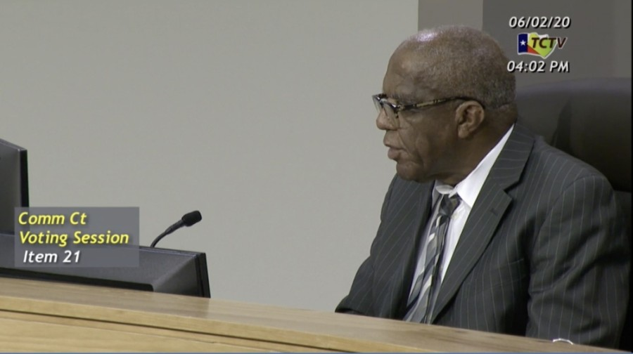A screen image of Sam Biscoe at a meeting of the Travis County Commissioners Court