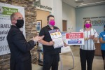 Scott Livingston (left), the League City's economic development director and a League City Turnaround Taskforce member, stands with Memorial Hermann employees who took the city's pledge to be safe during the coronavirus pandemic. (Courtesy city of League City)
