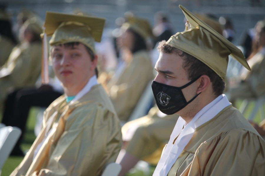 Few students and attendees wore face masks during the ceremony June 4, though students were seated in a socially distanced arrangement. (Andy Li/Community Impact Newspaper)