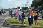 Peaceful protestors stand on the corner of RM 2222 and RM 620 June 5. (Courtesy Chris Backus)