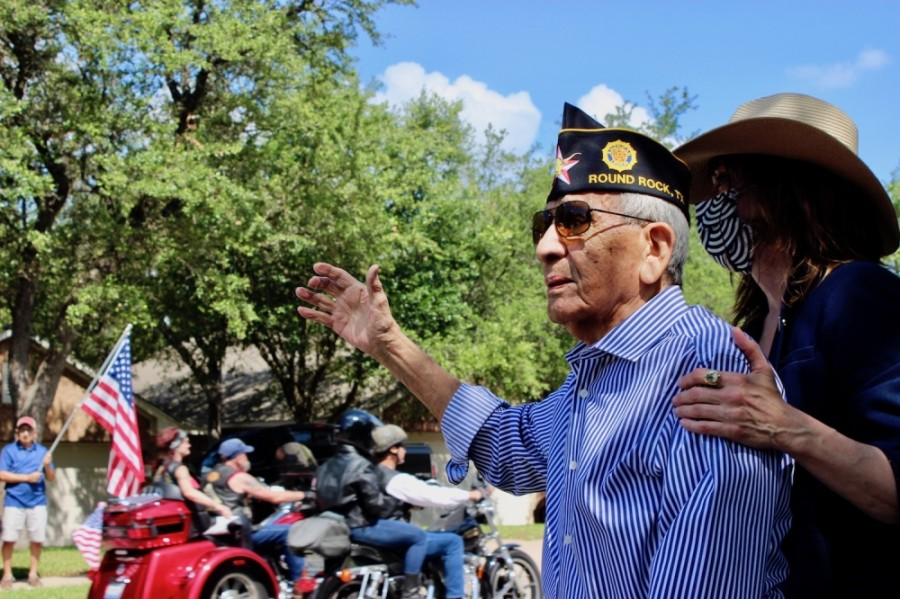 From left: Robert Sanchez is accompanied by his daughter Frances Dee Sanchez during a surprise parade to celebrate his 100th birthday. (Photos by Taylor Jackson Buchanan/Community Impact Newspaper)