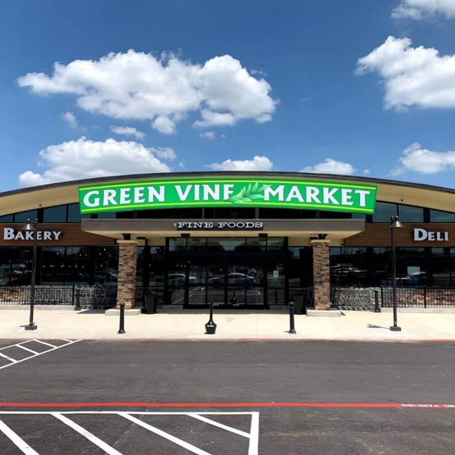 The market offers grocery items including dairy, fresh meat and produce, as well as an artisan bakery, cake section, specialty coffee bar and a service counter to order customized-portion meats. (Courtesy Green Vine Market)