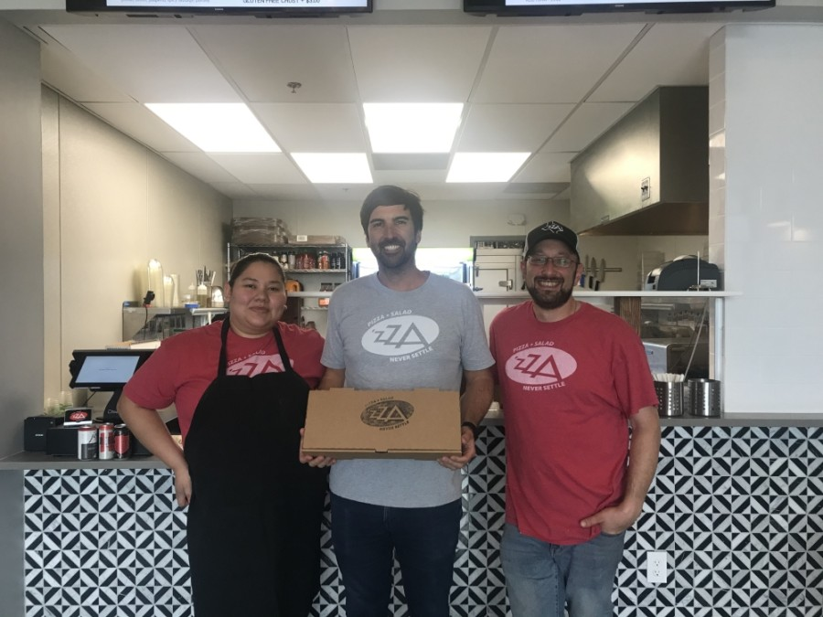 'Zza staff includes, from left to right, employee Stephany Riveria, co-owner Ryan McManus and General Manager Billy Oziransky. (Amy Rae Dadamo/Community Impact Newspaper)