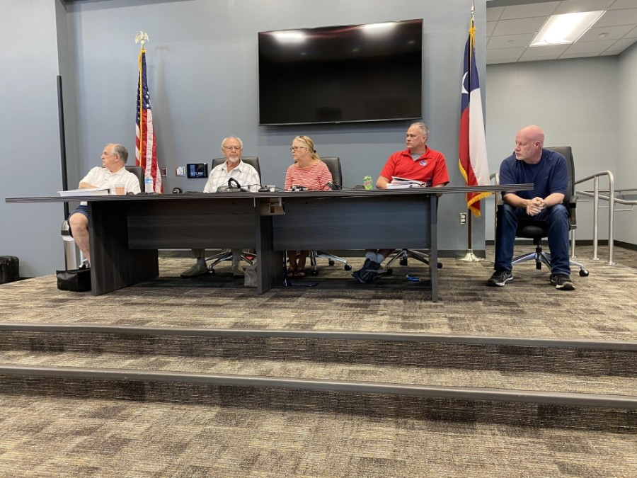 From left: Emergency Services District No. 11 board members Vice President Steve Williams, Secretary Fred Grundmeyer, President Karen Plummer, Assistant Treasurer Kevin Brost and Treasurer Robert Pinard met in a special meeting June 9. (Adriana Rezal/Community Impact Newspaper)
