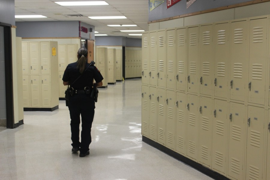 An Austin ISD Police Department officer walks that halls of Northeast Early College High School. (Nicholas Cicale/Community Impact Newspaper)