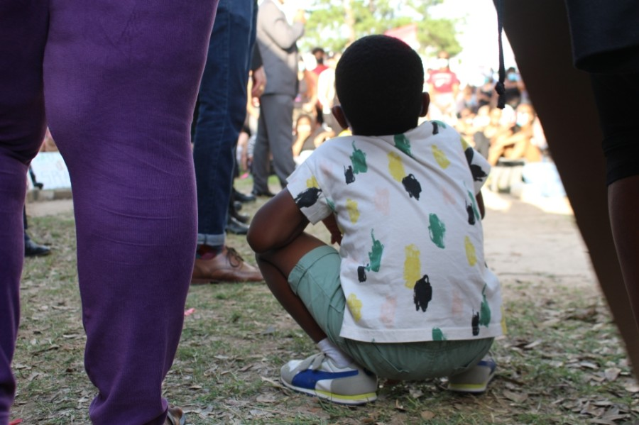 A boy listens to a speaker at the Katy for Black Lives Matter Protest held June 4. Fulshear High School will host a Rally for Unity on June 12. The event is meant to be family-friendly, educational and peaceful, an event co-organizer said. (Eva Vigh/Community Impact Newspaper)