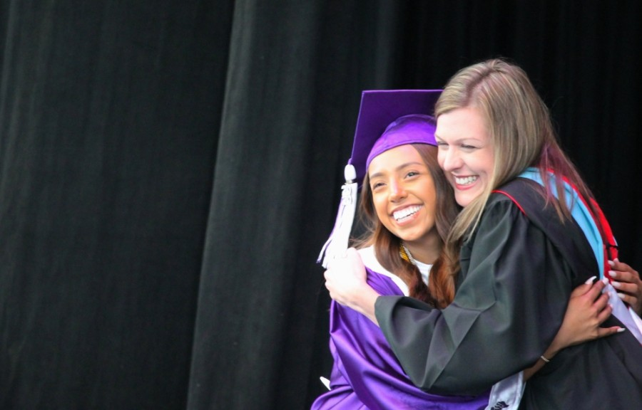 WHS Principal Stephanie Hodgins embraces a student as they walk across stage.(Andy Li/Community Impact Newspaper)