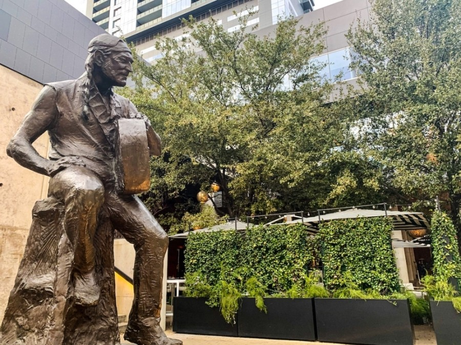 A statue of Willie Nelson sits in front of ACL Live at the Moody Theater at the corner of Lavaca and Second streets. (Community Impact Newspaper staff)