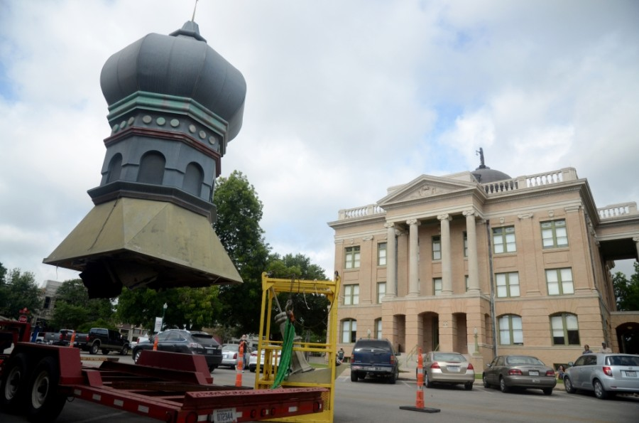 The onion dome on top of the Old Masonic Lodge Building, now Gumbo's North, was removed the morning of June 18. A new but identical dome will replace the old one after repairs to the building's roof are complete. (John Cox/Community Impact Newspaper)