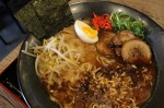 One of the restaurant's most popular ramen dishes is the Black Garlic Ramen, which includes pork-based soup with pork belly, egg, green onion, black mushroom, bean sprouts, red ginger, menma, roasted garlic and onion flakes. (Elizabeth Ucles/Community Impact Newspaper)