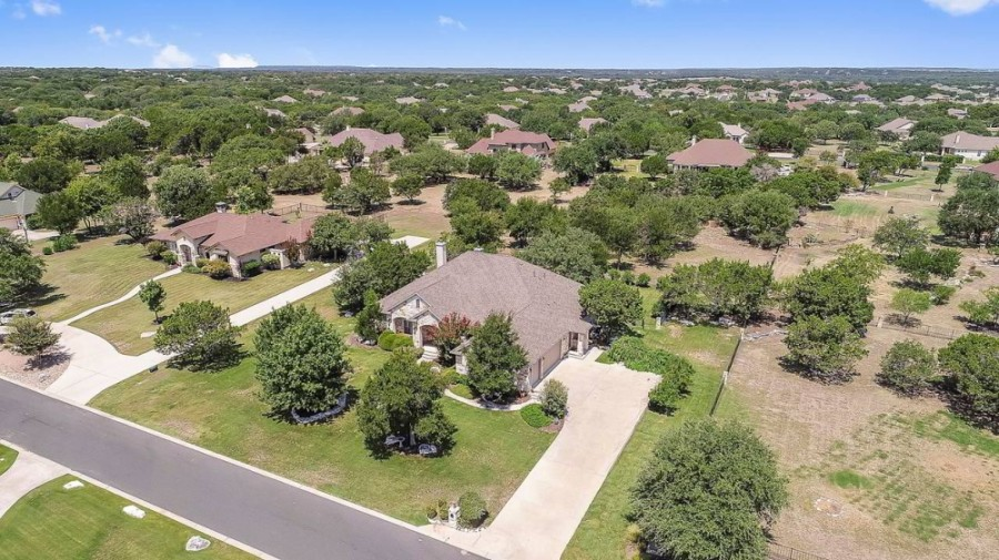 Woodland Park is a community that boasts spacious custom homes situated among native Texas trees. (Courtesy Stuart Sutton)