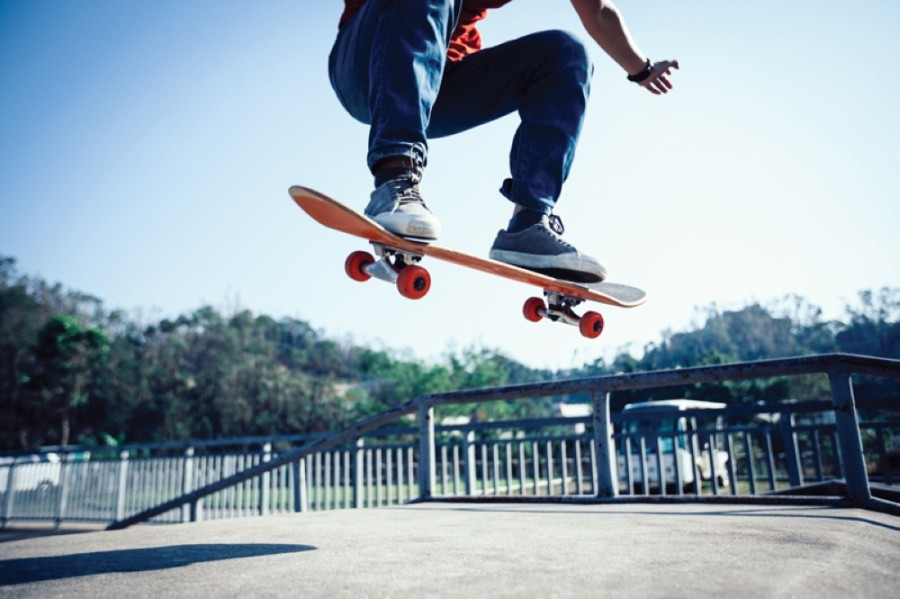 Kid skateboarding on a rail