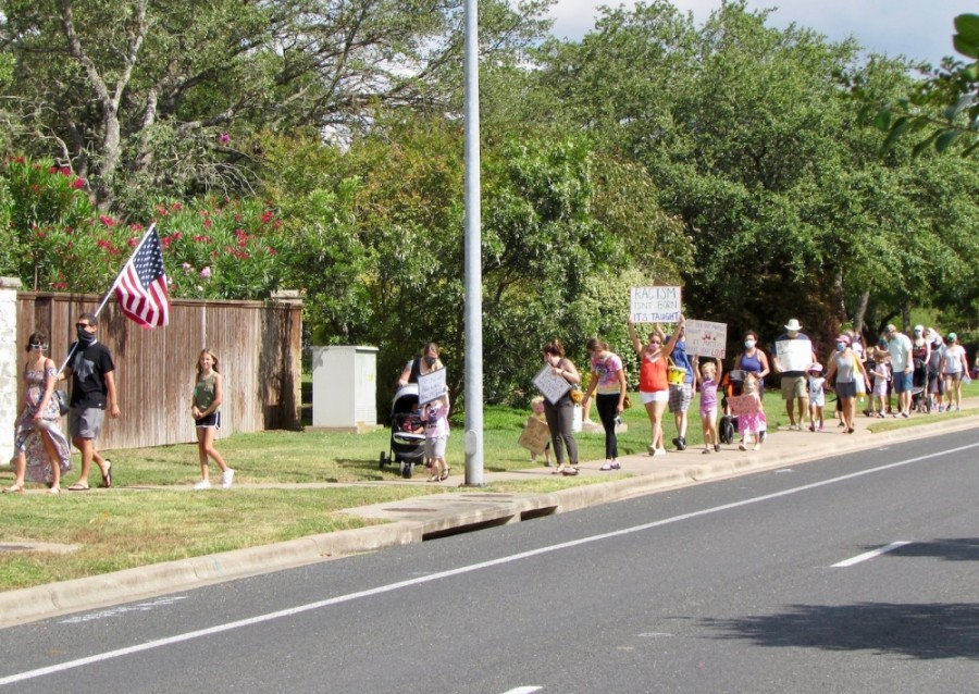 Sendera residents march down Davis Lane on June 19. (Nicholas Cicale/Community Impact Newspaper)
