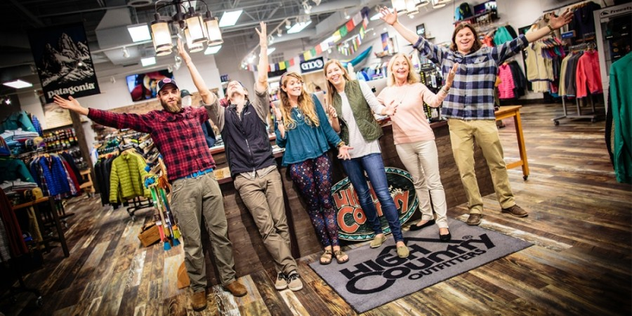 People inside High Country Outfitters store celebrating the grand opening