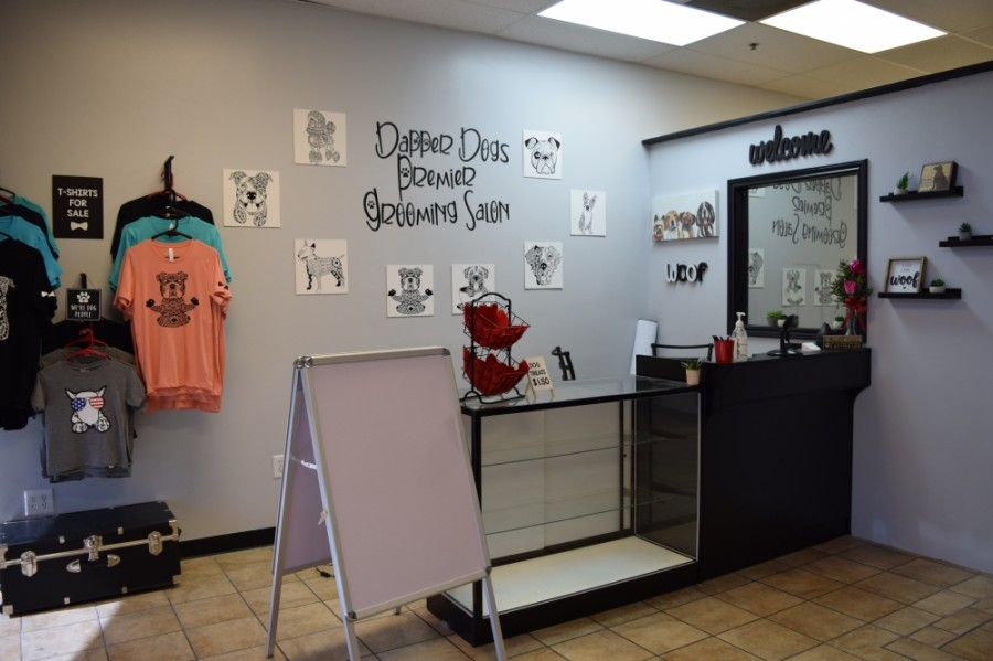 A retail area offers T-shirts and dog accessories. (Courtesy Dapper Dogs Premier Grooming Salon)
