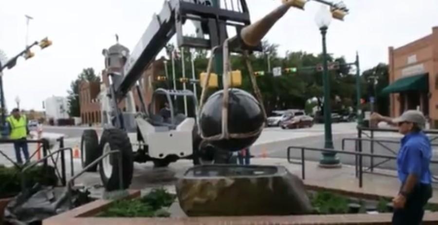 Crane holds granite sphere