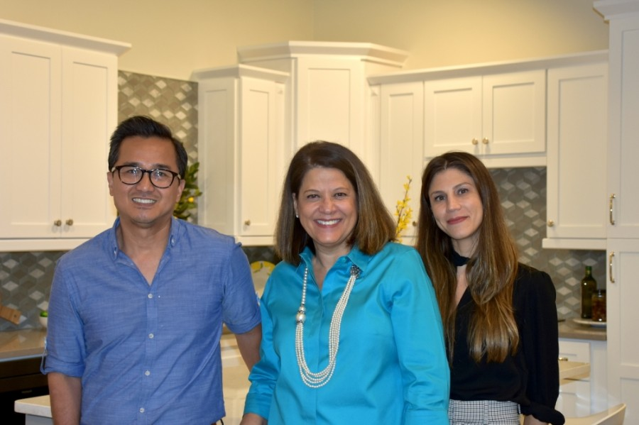 General manager Clarissa Rivera (center) works with consultants Jeffrey M. and Melanie B. to give clients their dream bathrooms and kitchens. (Makenzie Plusnick/Community Impact Newspaper)