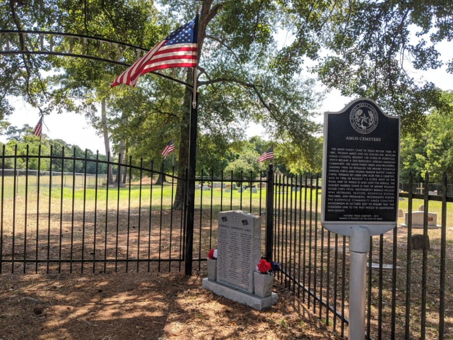A historical marker rests at Amos Cemetery East, recognizing the African American cemetery. (Anna Lotz/Community Impact Newspaper)