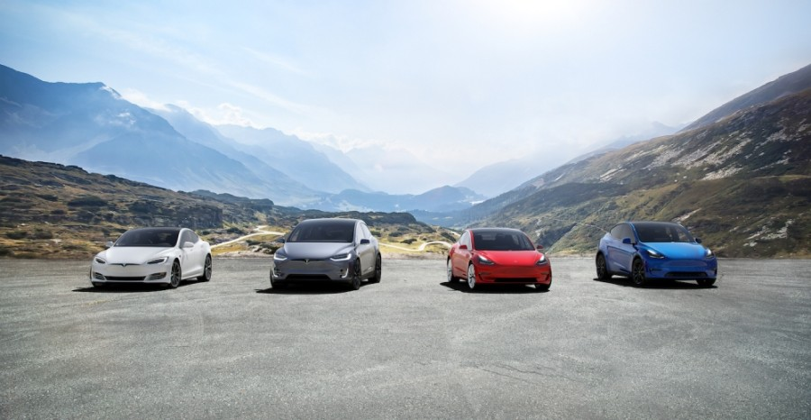 A photo of four Tesla vehicles
