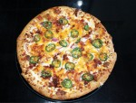 The jalapeño popper pizza is made with a cream cheese base and topped with cheddar cheese, garlic, red onions and jalapenos. (Eva Vigh/Community Impact Newspaper)