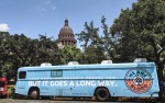 We Are Blood's mobile clinic is parked in front of the Texas Capitol Building.