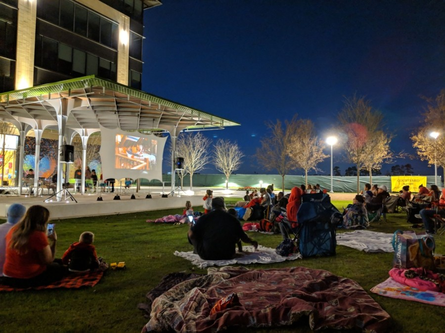 Redemption Square, a mixed-use district in the Generation Park development, invites the community to participate in summer movie nights. (Courtesy Integrate)