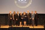 CoServ executives accepting award