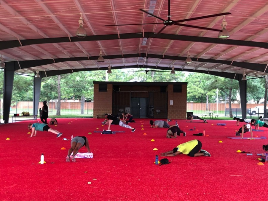 The outdoor pavilion at the Langham Creek Family YMCA has been converted into an open-air studio for group exercise classes, featuring 8,000 square feet of covered turf space outfitted with fitness equipment. (Courtesy YMCA of Greater Houston)
