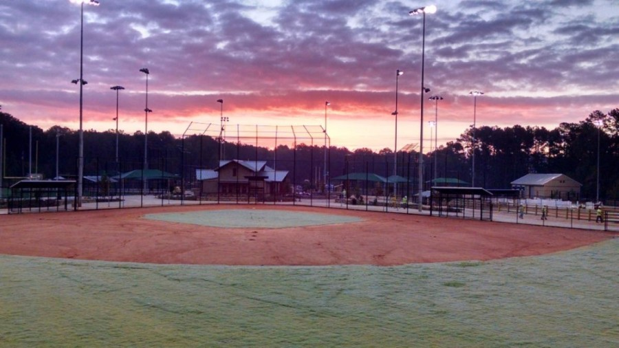 Baseball field with a sunset in the background
