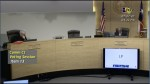 A screen capture of a virtual meeting of the Travis County Commissioners Court, feauring Gerald Daugherty and Sam Biscooe sitting in the courtroom