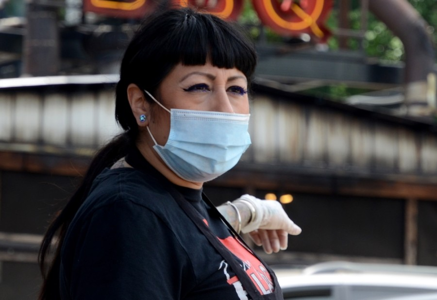 An employee at Terry Black's Barbecue in Austin works in a mask May 1. (John Cox/Community Impact Newspaper)