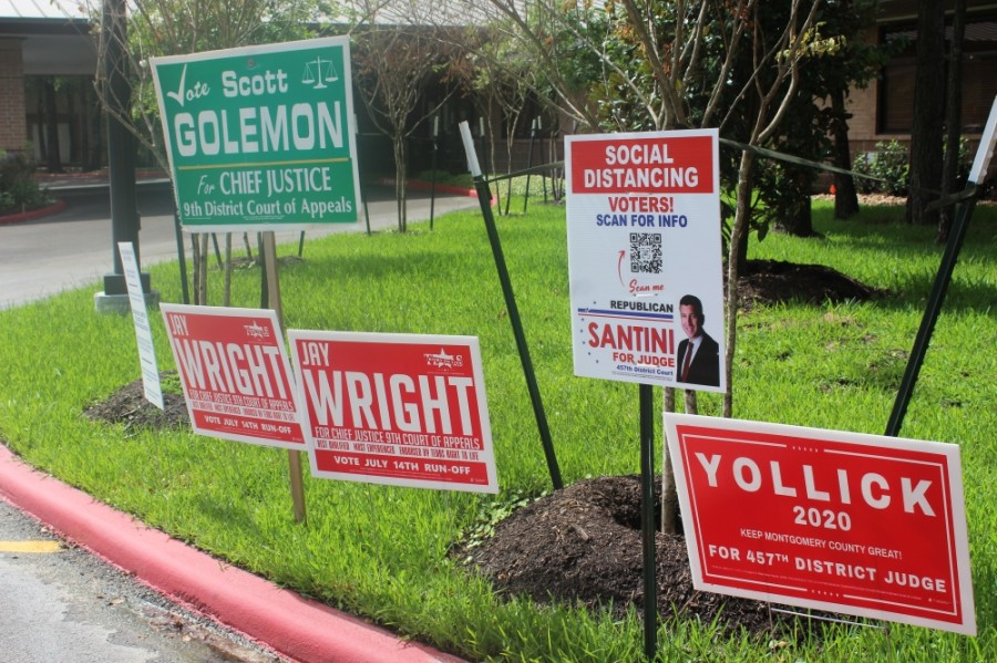Several candidates' campaign signs were set up outside the South County Community Center in The Woodlands during early voting for the July 14 runoff election. (Ben Thompson/Community Impact Newspaper)