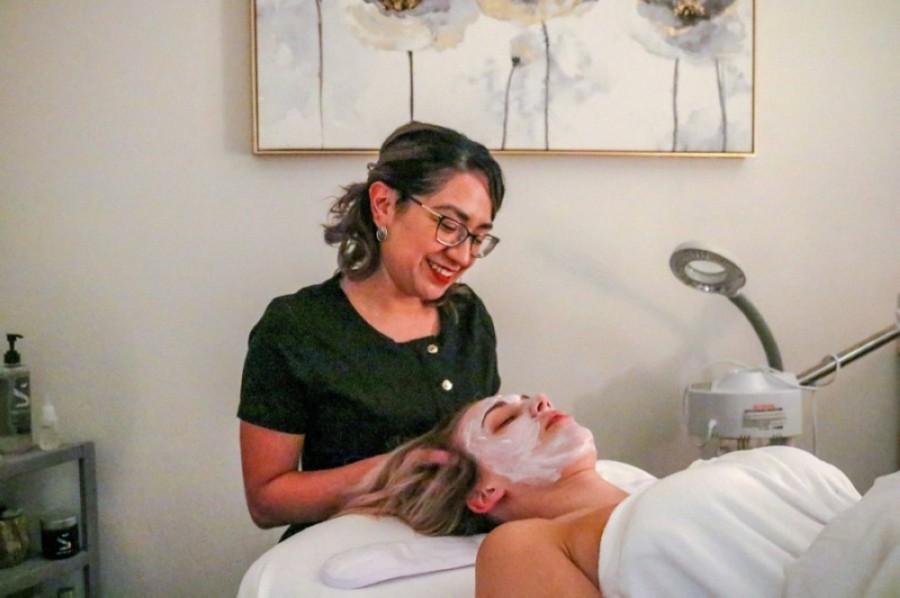 Esthetician Melissa Reyes gives a client a facial treatment. (Courtesy Trox Photography)