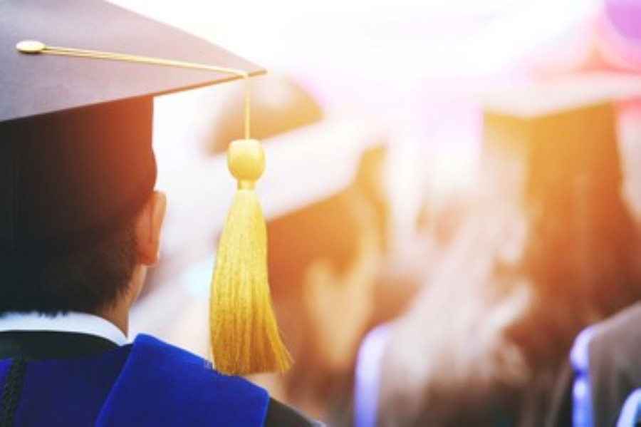 """Klein ISD graduating high school seniors were considered officially graduated on May 30 during a virtual """"Turn the Tassel"""" ceremony, and diplomas have since been distributed. (Courtesy Adobe Stock)"""