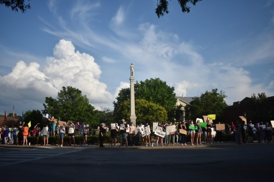 Protesters against racism gather at the base of the Confederate monument in Franklin's downtown on June 13. (Alex Hosey/Community Impact Newspaper)